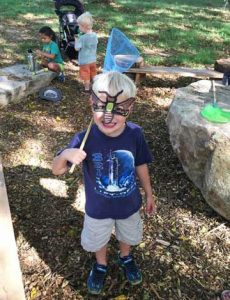 image of boy playing at the Nature Play Space